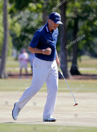Ryan Palmer pumps his fist after he made a birdie putt on the 14th green during the final round of the PGA Zurich Classic golf tournament at TPC Louisiana in Avondale, La., . Palmer and teammate Jon Rahm won the tournament