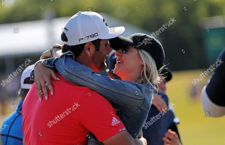 Jon Rahm, left, embraces his girlfriend Kelley Cahill after he and teammate Ryan Palmer won the PGA Zurich Classic golf tournament at TPC Louisiana in Avondale, La