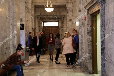 Stock Image of Democratic Rep. Monica Stonier, center, walks out of the House chambers, in Olympia, Wash. State lawmakers are wrapping up a 105-day legislative session in which they were tasked with passing a new, two-year state budget