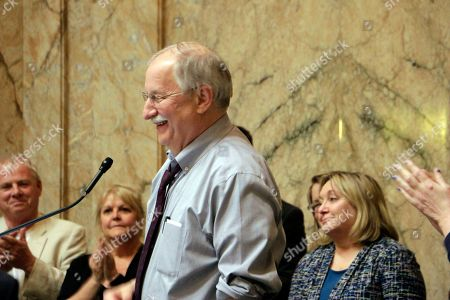 House Speaker Frank Chopp smiles following passage of a resolution honoring him, in Olympia, Wash. Chopp, who is stepping down from his leadership role after the legislative session ends, is the state's longest serving speaker