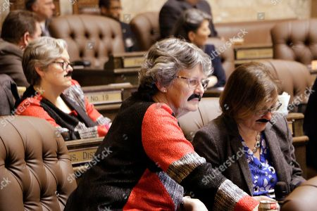 Stock Picture of Members of the House wear fake moustaches to honor Speaker of the House Frank Chopp, in Olympia, Wash. Chopp, who is stepping down from his leadership role after the legislative session ends, is the state's longest serving speaker