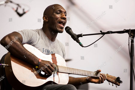 Stock Image of Cedric Burnside performs in the Blues Tent during the New Orleans Jazz & Heritage Festival in New Orleans