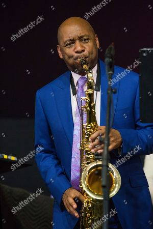 Branford Marsalis performs with his family in the Ellis Marsalis Family Tribute performance in the Jazz Tent during the New Orleans Jazz & Heritage Festival in New Orleans