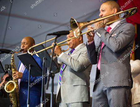 Branford Marsalis, Wynton Marsalis and Delfeayo Marsalis perform in the Ellis Marsalis Family Tribute in the Jazz Tent during the New Orleans Jazz & Heritage Festival in New Orleans