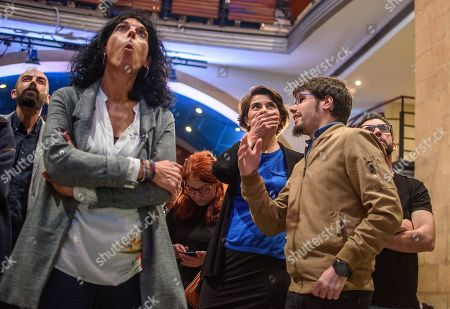 The general secretary of Euskadi Podemos (We can), Lander Martinez, the deputy of the Basque Parliament, Eukene Arana, (L) and supporters follow the results after the polls closed for the general elections in Bilbao, Basque Country, Spain, 28 April 2019. Nearly 36.9 million people were called to vote in the third Spanish general elections in four years.