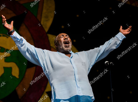 Stock Picture of Eddie Levert, of the O'Jays, greets fans on the Congo Square Stage during the New Orleans Jazz & Heritage Festival in New Orleans