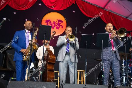 Branford Marsalis, Wynton Marsalis, Delfeayo Marsalis. Branford Marsalis, from left, Wynton Marsalis, and Delfeayo Marsalis perform during the Ellis Marsalis Family Tribute at the New Orleans Jazz and Heritage Festival, in New Orleans