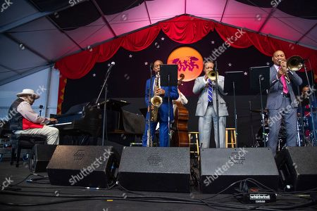 Ellis Marsalis Jr., Branford Marsalis, Wynton Marsalis, Delfeayo Marsalis. Ellis Marsalis Jr., from left, Branford Marsalis, Wynton Marsalis, and Delfeayo Marsalis perform during the Ellis Marsalis Family Tribute at the New Orleans Jazz and Heritage Festival, in New Orleans