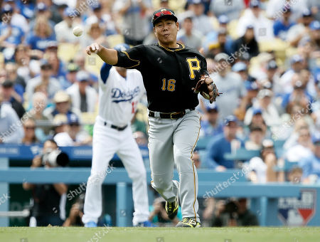 Pittsburgh Pirates third baseman Jung Ho Kang throws out Los Angeles Dodgers' Rich Hill on a sacrifice bunt during the fourth inning of a baseball game in Los Angeles