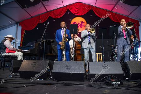Stock Picture of Ellis Marsalis Jr., Branford Marsalis, Wynton Marsalis, Delfeayo Marsalis. Ellis Marsalis Jr., from left, Branford Marsalis, Wynton Marsalis, and Delfeayo Marsalis perform during the Ellis Marsalis Family Tribute at the New Orleans Jazz and Heritage Festival, in New Orleans