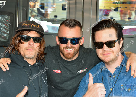 The Walking dead actor, Norman Reedus (left) and Josh McDermitt (right), stand beside Dow Chevrolet driver, Austin Dillon (middle), prior to the Geico 500 at Talladega Super Speedway in Talladega, AL. Kevin Langley/Sports South Media/CSM