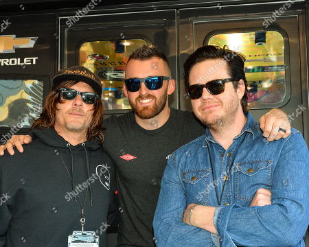The Walking dead actor, Norman Reedus (left) and Josh McDermitt (right), stand beside Dow Chevrolet driver, Austin Dillon, prior to the Geico 500 at Talladega Super Speedway in Talladega, AL. Kevin Langley/Sports South Media/CSM