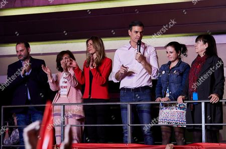 Spanish Prime Minister Pedro and Socialist Party (PSOE) candidate for prime minister Pedro Sanchez delivers a speech beside his wife Begona Gomez and other PSOE leaders Jose Luis Abalos and Carmen Calvo Poyato