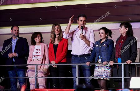 Spanish Prime Minister Pedro and Socialist Party (PSOE) candidate for prime minister Pedro Sanchez delivers a speech beside his wife Begona Gomez and other PSOE leaders Jose Luis Abalos and Carmen Calvo Poyato during an election night rally