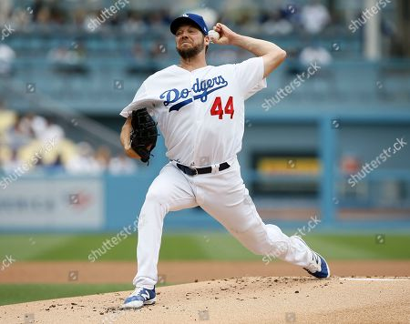 Los Angeles Dodgers starting pitcher Rich Hill delivers to a Pittsburgh Pirates batter during the first inning of a baseball game in Los Angeles