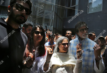 Abhishek Bachchan, Amitabh Bachchan, Jaya Bachchan, Aishwarya Rai. Bollywood star Amitabh Bachchan, right along with his wife Jaya Bachchan, daughter in law Aishwarya Rai, second left and son Abhishek Bachchan, left poses for the media after casting their vote at a polling station in Mumbai, India . Indians were voting Monday in the fourth phase of a staggered national election, with Prime Minister Narendra Modi's Hindu nationalist party facing a major test as it looks to govern for another five years