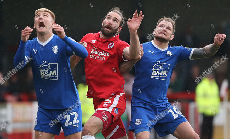 Crawley's Joe McNerney is challenged by Tranmere's Harvey Gilmour  and Tranmere's James Norwood during the EFL 2 match between Crawley Town and Tranmere Rovers at the Peoples Pension Stadium in Crawley. 04 May 2019