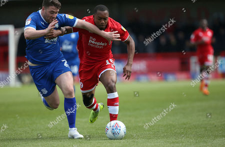Crawley's Ashley Nathaniel-George vies for the ball against  Tranmere's Adam Buxton during the EFL 2 match between Crawley Town and Tranmere Rovers at the Peoples Pension Stadium in Crawley. 04 May 2019