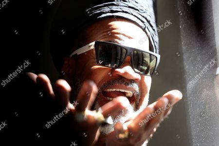 Brazilian artist Carlinhos Brown poses for the photographer as he present his art exhibition 'Carlinhos Brown. La mirada que escucha' (Carlinhos Brown. The sight that listens) at the Fundacion Telefonica exhibition center in Madrid, Spain, 29 April 2019. The show featuring 14 big art works by the Brazilian composer, singer and percussionist runs from 01 May to 02 June.