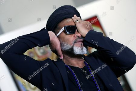 Stock Picture of Brazilian artist Carlinhos Brown poses for the photographer as he present his art exhibition 'Carlinhos Brown. La mirada que escucha' (Carlinhos Brown. The sight that listens) at the Fundacion Telefonica exhibition center in Madrid, Spain, 29 April 2019. The show featuring 14 big art works by the Brazilian composer, singer and percussionist runs from 01 May to 02 June.