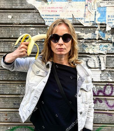 In this photo made, Polish actress Magdalena Cielecka aims a banana like a gun at her head to protest the removal of an art work from the National Museum in Warsaw that features a woman eating a banana with visible pleasure, which the conservative authorities say is obscene. wld