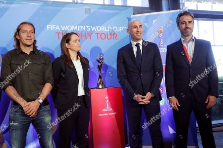 (L-R) Former Spanish soccer player Michel Salgado; FIFA Head of Competitions - Women's Football Division, Sarah Booth; Spanish Royal Soccer Federation's President, Luis Rubiales; and Spanish Women's National Soccer Team's head coach, Jorge Vilda (R), (2-R); pose for the photographers during the presentation of the trophy of Women's Soccer World Cup, as part of the Spanish Soccer Federation's extraordinary General Assembly, in Madrid, Spain, 29 April 2019. The FIFA Women's Soccer World Cup will be held from 07 June to 07 July 2019 in France.