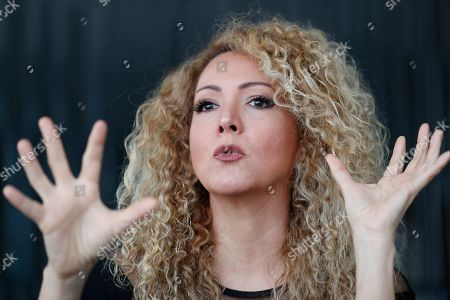 """Panamanian singer and songwriter Erika Ender smiles as she speaks during an interview with The Associated Press in Miami. Even though Ender shot to fame after writing the mega-hit """"Despacito"""" with Luis Fonsi, she already had a prolific 20-year career"""