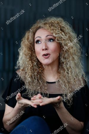 "Panamanian singer and songwriter Erika Ender speaks during an interview with The Associated Press in Miami. Even though Ender shot to fame after writing the mega-hit ""Despacito"" with Luis Fonsi, she already had a prolific 20-year career"