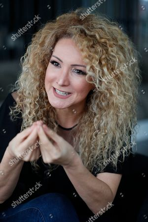 """Stock Picture of Panamanian singer and songwriter Erika Ender speaks during an interview with The Associated Press in Miami. Even though Ender shot to fame after writing the mega-hit """"Despacito"""" with Luis Fonsi, she already had a prolific 20-year career"""