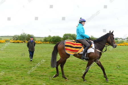 Currabeg Stables, Curragh. The John Oxx trained SKITTER SCATTER and Stephanie Roussell at morning work watched by the trainer, ahead of this weekend's Qipco 1000 Guineas at Newmarket.
