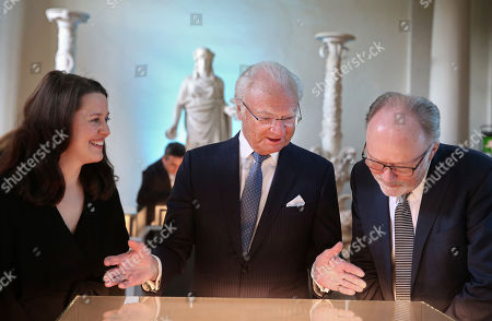 Stock Picture of King Carl Gustaf with artists Valentine Isaeus-Berlin and Johan Scot during the inauguration of 'The Thinking Hand' scholarship competition for young draftsmen at the Bernadotte Library in the Royal palace in Stockholm