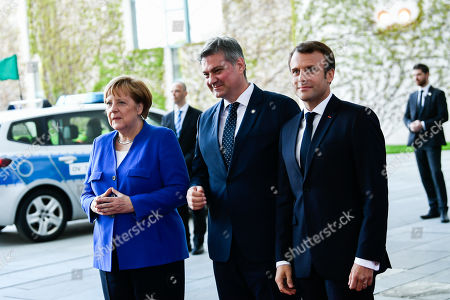 (L-R) German Chancellor Angela Merkel, President of the Council of Ministers of Bosnia and Herzegovina Denis Zvizdic and French President Emmanuel Macron pose for photographers during the arrivals for a 'Western Balkans Conference' at the Chancellery in Berlin, Germany, 29 April 2019. German Chancellor Angela Merkel and French President Emmanuel Macron are hosting a meeting of European Union officials and Western Balkan leaders to restart talks between Serbia and Kosovo.