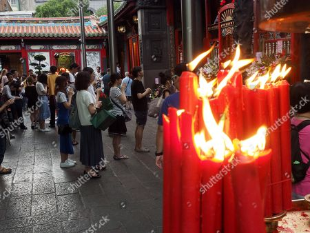 Candles burn at Longshan Temple in Taipei, Taiwan, 29 April 2019. Starting 01 May, Longshan Temple, Taipei's largest Buddhist temple, will ban burning candles to prevent fire and reduce air pollution. More than 60 per cent of Taiwanese follow Buddhism or Taoism and burn incense and candles at home or in temples.