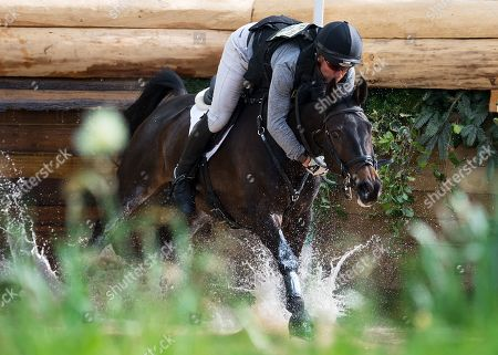 Tom Crisp (GBR) hangs on to Liberty and Glory during the Cross Country Test at Badminton