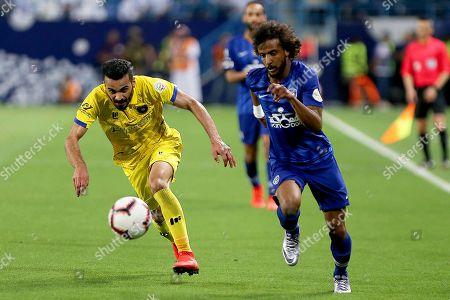 Al-Taawoun's Madallah Alolayan (L) in action against Al-Hilal's Yasser Al-Shahrani (R) during the Saudi Professional League soccer match between Al-Hilal S.FC and Al-Taawoun FC at King Saud University Stadium in Riyadh, Saudi Arabia, 29 April 2019.