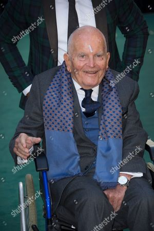Actor Sir Ian Holm poses for photographers upon arrival at the 'Tolkien' premiere in London