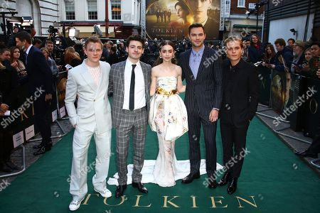 Actors, from left, Patrick Gibson, Anthony Boyle, Lily Collins, Nicholas Hoult and Tom Glynn-Carney pose for photographers upon arrival at the 'Tolkien' premiere in London