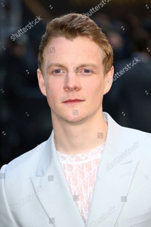 Patrick Gibson poses for photographers upon arrival at the 'Tolkien' premiere in London