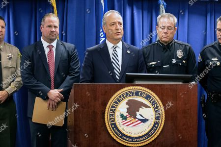 US Attorney Nicola T. Hanna of the Central District of California delivers a speech flanked by FBI Special Agent Ryan Young (L) and LAPD Chief Michel Moore (R) during a press conference uncovering details of the arrest of Mark Steven Domingo on charges of preparing terrorist attacks at the US Attorney's Office in the Federal Building in Los Angeles, California, USA, 29 April 2019. During the press conference, it was announced that 26 year-old, Mark Steven Domingo, former military and recently converted to Islam, was arrested as he was preparing bomb attacks in Los Angeles by a joint task force of the LA County Sheriff department, LA Police Department, and FBI.