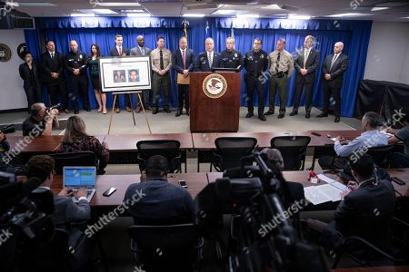 Stock Picture of US Attorney Nicola T. Hanna of the Central District of California delivers a speech flanked by FBI Special Agent Ryan Young (L) and LAPD Chief Michel Moore (R) during a press conference uncovering details of the arrest of Mark Steven Domingo on charges of preparing terrorist attacks at the US Attorney's Office in the Federal Building in Los Angeles, California, USA, 29 April 2019. During the press conference, it was announced that 26 year-old, Mark Steven Domingo, former military and recently converted to Islam, was arrested as he was preparing bomb attacks in Los Angeles by a joint task force of the LA County Sheriff department, LA Police Department, and FBI.