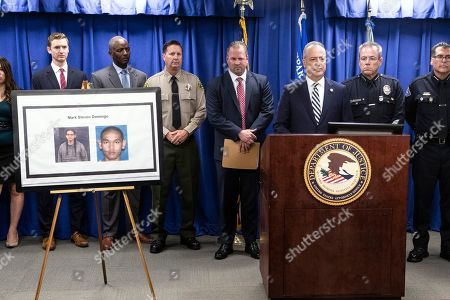 Stock Image of US Attorney Nicola T. Hanna of the Central District of California delivers a speech flanked by FBI Special Agent Ryan Young (L) and LAPD Chief Michel Moore (R) during a press conference uncovering details of the arrest of Mark Steven Domingo on charges of preparing terrorist attacks at the US Attorney's Office in the Federal Building in Los Angeles, California, USA, 29 April 2019. During the press conference, it was announced that 26 year-old, Mark Steven Domingo, former military and recently converted to Islam, was arrested as he was preparing bomb attacks in Los Angeles by a joint task force of the LA County Sheriff department, LA Police Department, and FBI.