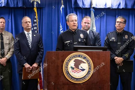 LAPD Chief Michel Moore delivers a speech flanked by FBI Special Agent Ryan Young (R) and US Attorney for the Central District of California Nicola T. Hanna (L) during a press conference uncovering details of the arrest of Mark Steven Domingo on charges of preparing terrorist attacks at the US Attorney's Office in the Federal Building in Los Angeles, California, USA, 29 April 2019. During the press conference, it was announced that 26 year-old, Mark Steven Domingo, former military and recently converted to Islam, was arrested as he was preparing bomb attacks in Los Angeles by a joint task force of the LA County Sheriff department, LA Police Department, and FBI.