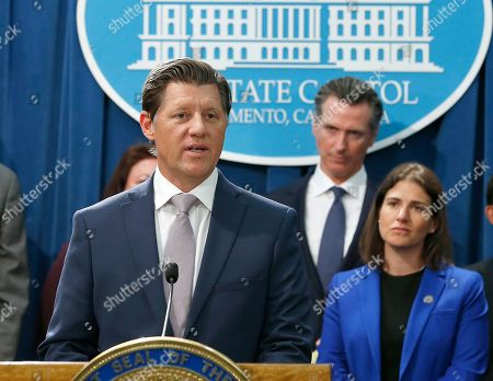 Stock Image of Republican State Sen. Brian Jones, left, discusses the weekend shooting at the Poway Chabad Synagogue located in his San Diego-area district, during a news conference, in Sacramento, Calif. California Gov. Gavin Newsom, second from right, said he would increase spending to pay for increasing security at nonprofit organizations at higher risk because of their ideology, beliefs or mission