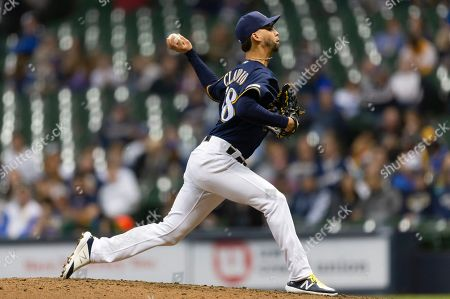 Milwaukee Brewers relief pitcher Alex Claudio #58 delivers a pitch during the Major League Baseball game between the Milwaukee Brewers and the Colorado Rockies at Miller Park in Milwaukee, WI
