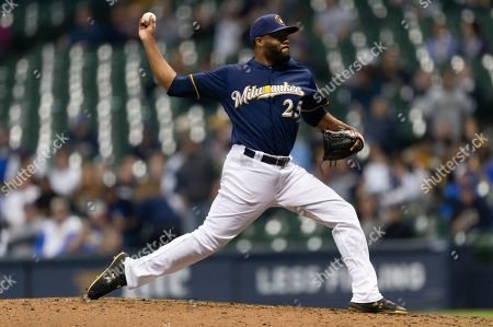 Milwaukee Brewers relief pitcher Jay Jackson #25 delivers a pitch during the Major League Baseball game between the Milwaukee Brewers and the Colorado Rockies at Miller Park in Milwaukee, WI