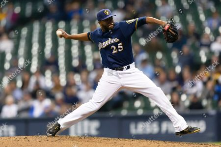 Milwaukee Brewers relief pitcher Jay Jackson #25 strikes out his first batter since being called up today in his Brewers debut during the Major League Baseball game between the Milwaukee Brewers and the Colorado Rockies at Miller Park in Milwaukee, WI