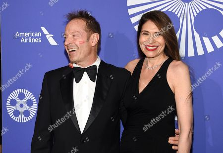 Simon Kirke, Maria Angelica. Musician Simon Kirke, left, and wife Maria Angelica attend the Film Society of Lincoln Center's 50th anniversary gala at Alice Tully Hall, in New York
