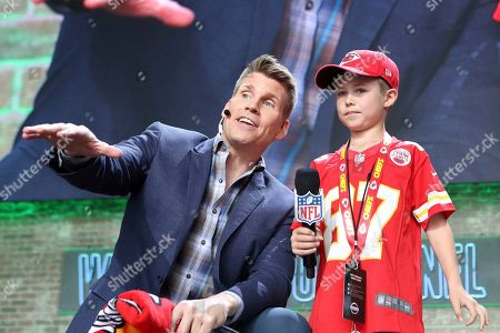 Stock Image of NFL RedZone host Scott Hanson is seen with a young Kansas City Chiefs fan on Day 3 of the NFL football draft, in Nashville, Tenn. on