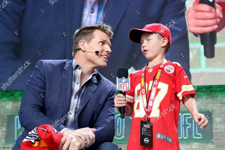 NFL RedZone host Scott Hanson is seen with a young Kansas City Chiefs fan on Day 3 of the NFL football draft, in Nashville, Tenn. on