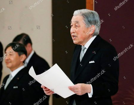 Japan's Emperor Akihito speaks during the ceremony of his abdication in front of other members of the royal families and top government officials at the Imperial Palace in Tokyo, . The 85-year-old Akihito ends his three-decade reign on Tuesday as his son Crown Prince Naruhito, left, will ascend the Chrysanthemum throne on Wednesday